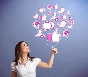 Young pretty woman holding social icon balloon