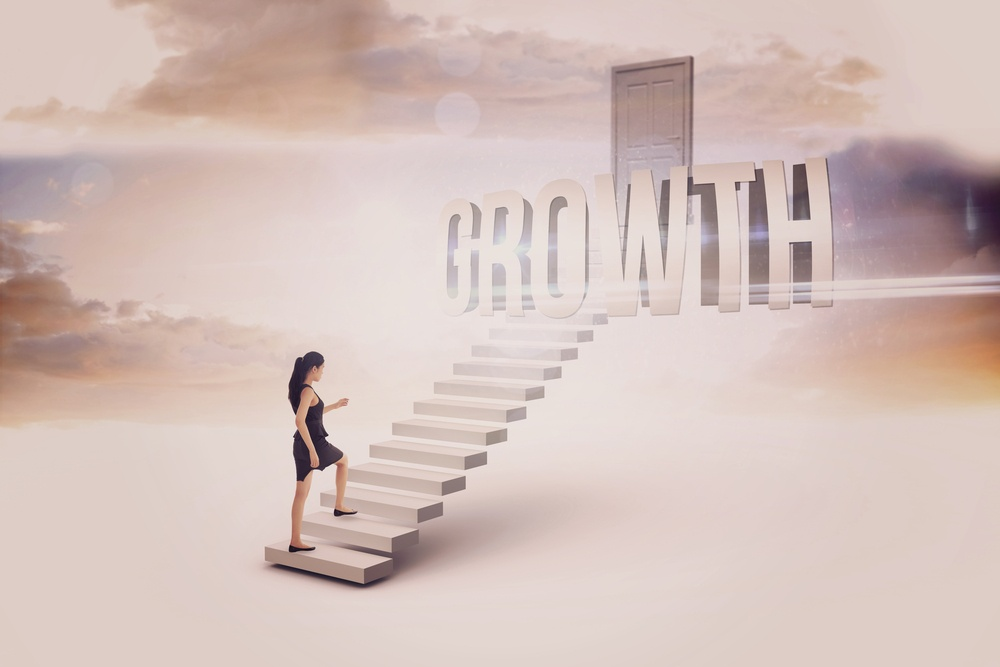 The word growth and businesswoman stepping up against white steps leading to closed door