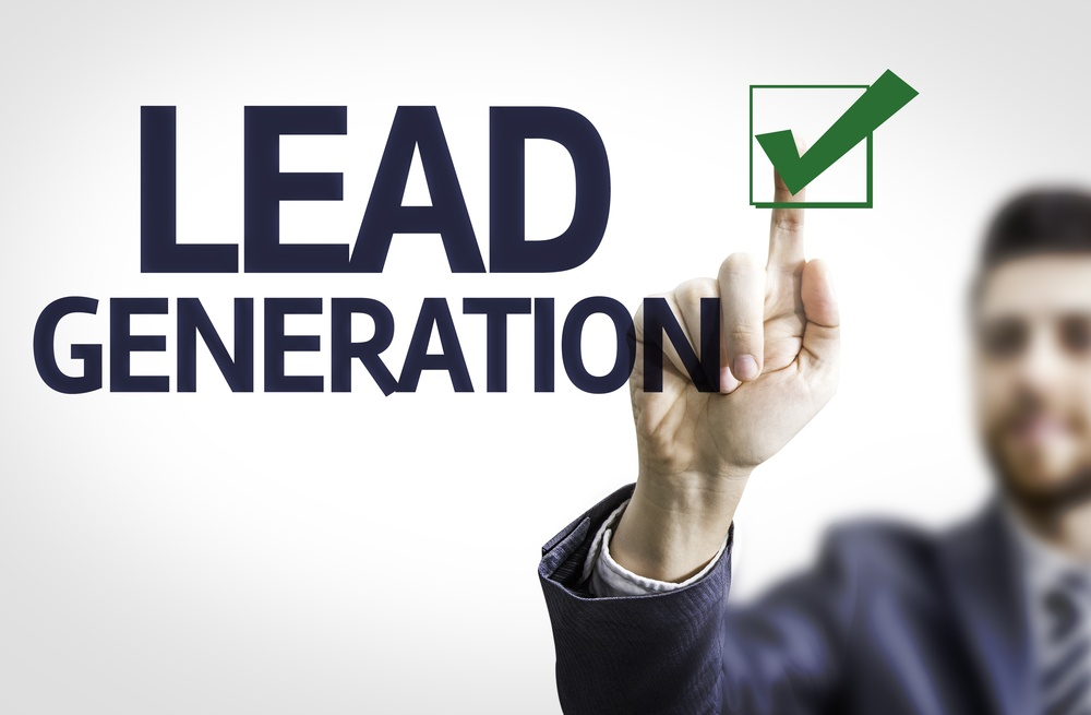 Business man pointing the text Lead Generation